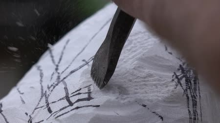 munkaeszközként : The artist creating sculpture of stone. Art studio. Slow Motion. Close-up shot. Artist working with stone and sculpting statue