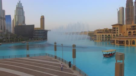 決算 : Aerial. Dubai musical Fountain. Flying near Dubai Mall and Burj Khalifa.