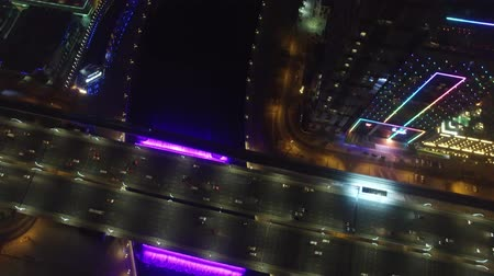 в середине : Aerial. Illuminated Waterfall at the Sheikh Zayed Bridge. Dubai Water Canal.