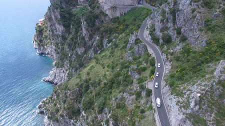 speed tunnel : Aerial view. Cars driving on mountain road. Italy.