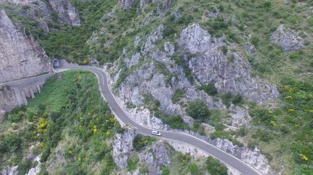 obec : Aerial view. Cars driving on mountain road. Italy