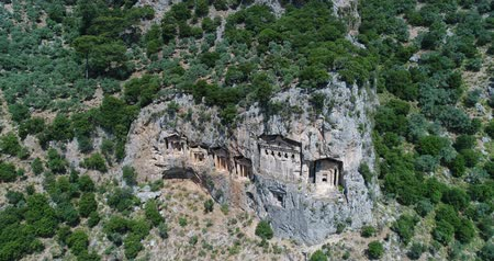 királyok : Aerial. Ancient Lycian rock-cut tombs, Fethiye, Turkey. Camera moves down. 4K.