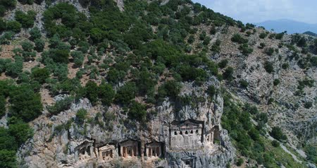 anlamlı : Aerial. Ancient Lycian rock-cut tombs, Fethiye, Turkey. Camera moves down. 4K.