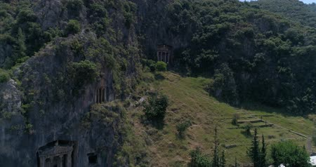 fethiye : Aerial. Ancient Lycian rock-cut tombs, Fethiye, Turkey. Camera moves up, 4K.