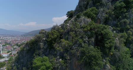 királyok : Aerial. Ancient Lycian rock-cut tombs, Fethiye, Turkey. Camera moves up, 4K.