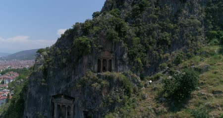 anlamlı : Aerial. Ancient Lycian rock-cut tombs, Fethiye, Turkey. Camera moves up, 4K.