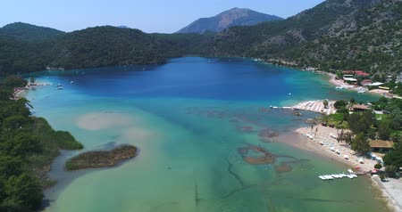 fethiye : Aerial. Flying above Oludeniz beach. Beautiful Bay with crystal water. Turkey. 4K.