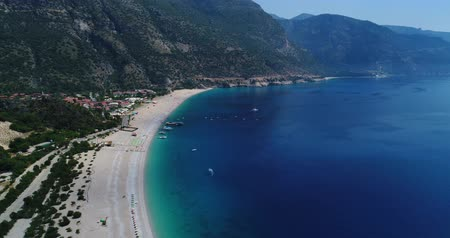 Aerial. Flying above Oludeniz beach. Beautiful Bay with crystal water. Turkey. 4K.