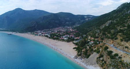 Aerial. Flying above Oludeniz town and seacoast. Turkey, 4K.