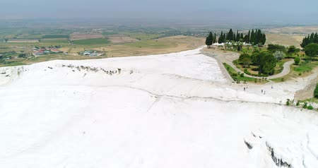 terra : Aerial. Pamukkale terraces or cotton Castle. Brilliantly white calcium cliff. Turkey. 4K.