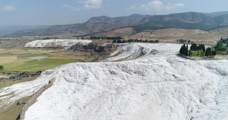 Aerial. Pamukkale terraces or cotton Castle. Brilliantly white calcium cliff. Turkey. 4K.