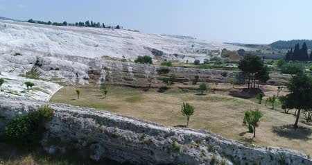 travertino : Aerial. Pamukkale terraces or cotton Castle. Brilliantly white calcium cliff. Turkey. 4K.