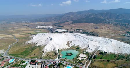 Aerial. Pamukkale - famous gleaming white calcite travertines on the cliff.