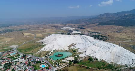 molas : Aerial. Pamukkale - famous gleaming white calcite travertines on the cliff.