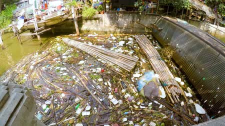 Pollution: garbage, plastic, and wastes in the Chao Phraya river, Thailand. Stock Footage