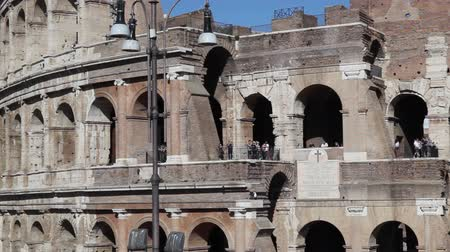colloseum : Tourists and visitors overlook the railing of the Coliseum facade.