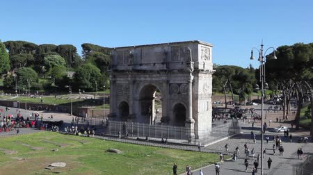 arch of constantine : Arch of Constantine, a crowd of tourists and citizens walk in the pedestrian area in front of the ancient monument. Stock Footage