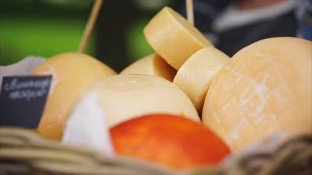 emmental : Pile of different cheese heads in basket. Macro video. Fresh homemade cheese. Healthy food. Dairy products. Close up view
