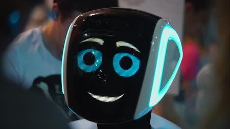 robot : Big funny robot with big blue eyes smiling and talking. Antropomorf robot. Face screen friendly robot.