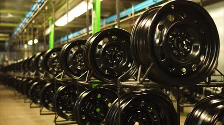 lemezek : Finished pressed steel wheels are on shelves in production room in a factory. Modern full-cycle steel wheel production plant.