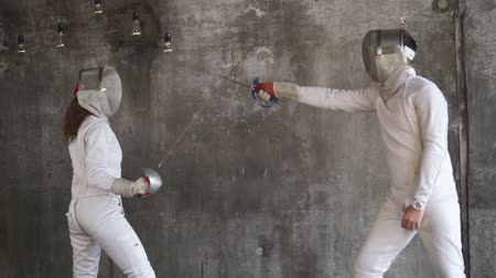meç : Two fencers are attacking each other without defending. They are practicing head attack with sword. Stok Video
