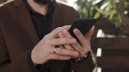 sem camisa : close up shot of the mans hands, people quickly print text sms on the mobile phone, it is on the street and keeps fingers modern gadget Stock Footage
