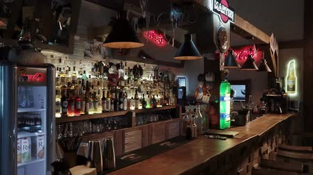 vermouth : Russia Rosa Khutor-February, 2018: view of the bar in which are bottles of alcohol bar tools, a sign of martini and other things typical of drinking establishments Stock Footage
