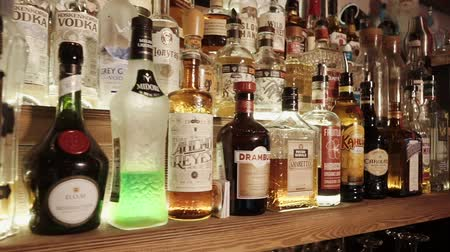 elite : Rosa Khutor, RUSSIA - FEB, 2018: panorama of bar shelves with standing elite spirit drinks. Bottles are standing in ranges and camera is moving