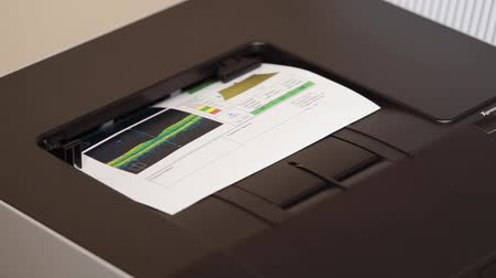 vision correction : close up shot of the printer, which is in a private clinic, the machine prints the results of the retina tamogram and eyeball, the results will be discussed by an ophthalmologist Stock Footage