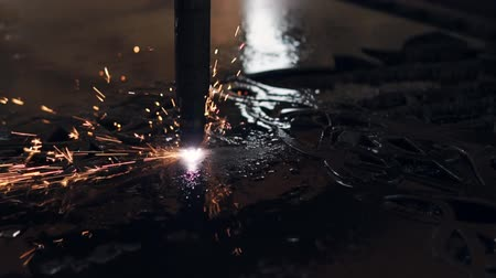 laser engraving : Close up shot of a laser cutting through the metal. Automatic work of a industrial machine. Programmed machine doing ornament. Stock Footage