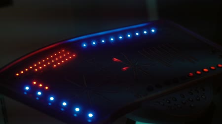 clique : Close-up of a space onboard computer from alien ship. Read and blue ligths on a computer panel. Space ship technologies in a museum. Stock Footage