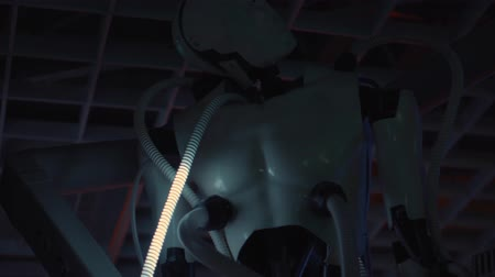 droid : Hang robotic body with glowing tubes connected to it. Machine cyborg as museum exhibit piece. Hitech ufo technology. Stock Footage