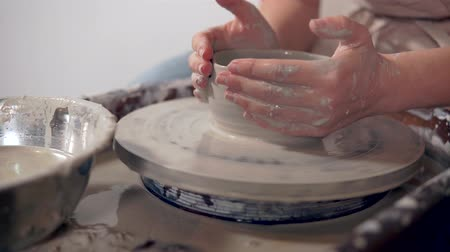 zanaat : Process of handmade modeling clay tableware on potters wheel, close-up of hands