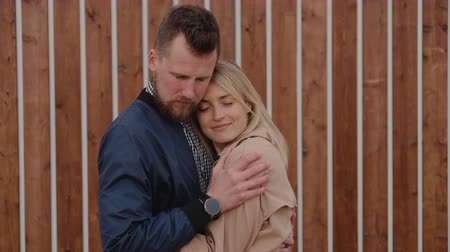 Lovers are hugging tenderly outdoors, looking to each other with love Stok Video