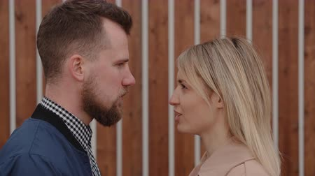 dispute : Couple quietly arguing with each other.