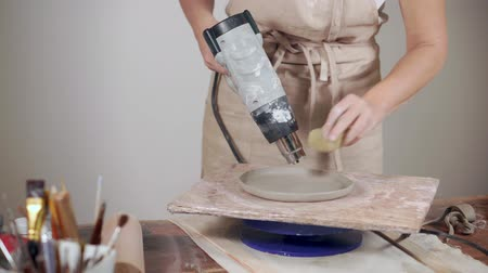 shaping : Female potterer making ceramic products Stock Footage