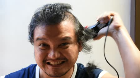 barbering : Asian man use equipment clippers hair cut by myself
