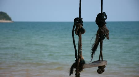 travel tropical : Swing at beach and blue sea for travel in Thailand