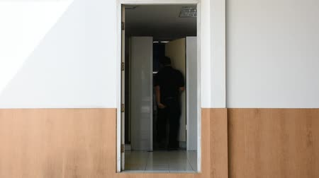 sanitário : Asian man quickly run to the toilet for bowel problem