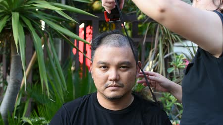 barbering : Asian man getting his hair shaved
