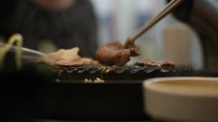 wagyu : Grilled raw meat (barbeque,bbq) cooking on wagyu grill in BBQ. yakiniku grill buffet restaurant