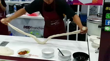 Bangkok, Thailand - July 7, 2018 : Slow motion of Unidentified chef demonstrating how to make flour for the noodles in restaurant. Stock mozgókép