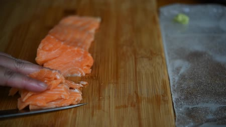 sea piece : Asian mistake chef move salmon fall from knife for japanese food delicacy consisting sashimi salmon of very fresh raw salmon fish sliced into thin pieces in japanese restaurant Stock Footage