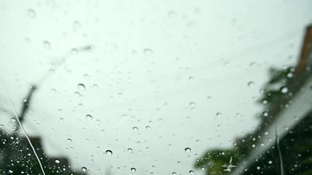 Water drops steam of rain on car windshield window glass after the rain Stock Footage