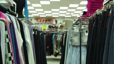 tradicional : Hangers on the rack at clothing store, tracking shot close-up