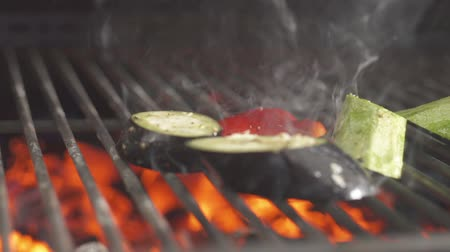 tongs : A chef with gloves frying vegetables on a grill. Stock Footage