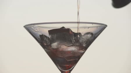 vermouth : Cooking martini glass with ice and olives. Stock Footage