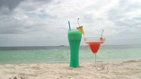 freddo : Cocktails are on the sand next to the sea Stock Footage