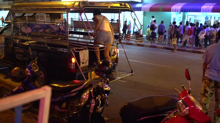 rickshaw : A woman sits in a Thai taxi Stock Footage