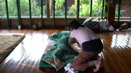 relieve : Masseuse doing Thai womans foot massage.